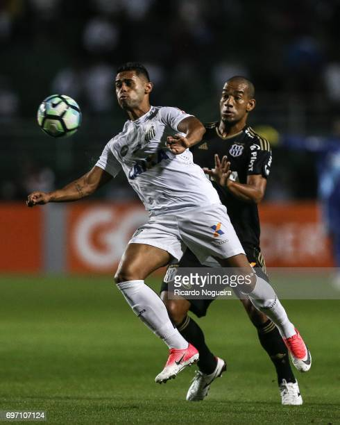 Kayke of Santos battles for the ball with Rodrigo of Ponte Preta during the match between Santos and Ponte Preta as a part of Campeonato Brasileiro...