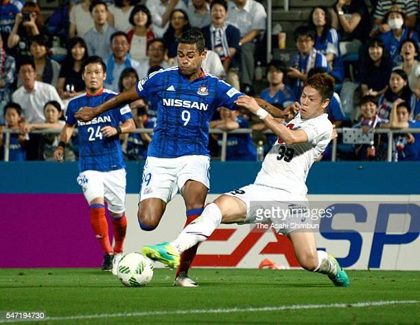 Kayke of Yokohama FMarinos and Masahiko Inoha of Vissel Kobe compete for the ball during the JLeague match between Yokohama FMarinos and Vissel Kobe...