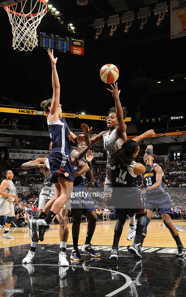 Kayla Alexander of the San Antonio Silver Stars shoots against Tan White of the Connecticut Sun at the ATT Center on July 20 2013 in San Antonio...