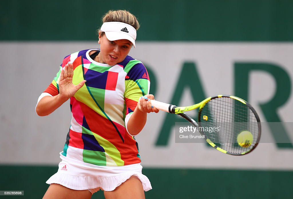 Kayla Day of the United States hits a backhand during the Girls Singles first round match against Loudmilla Bencheikh of France on day eight of the 2016 French Open at Roland Garros on May 29, 2016 in Paris, France.