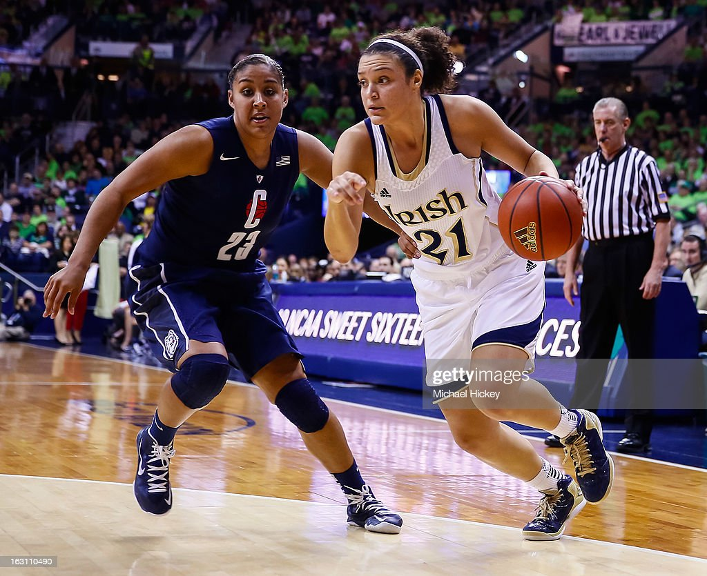 Kayla McBride #21 of the Notre Dame Fighting Irish dribbles the ball around Kaleena Mosqueda-Lewis #23 of the Connecticut Huskies at Purcel Pavilion on March 4, 2013 in South Bend, Indiana. Notre Dame defeated Connecticut 96-87 in triple overtime to win the Big East regular season title.