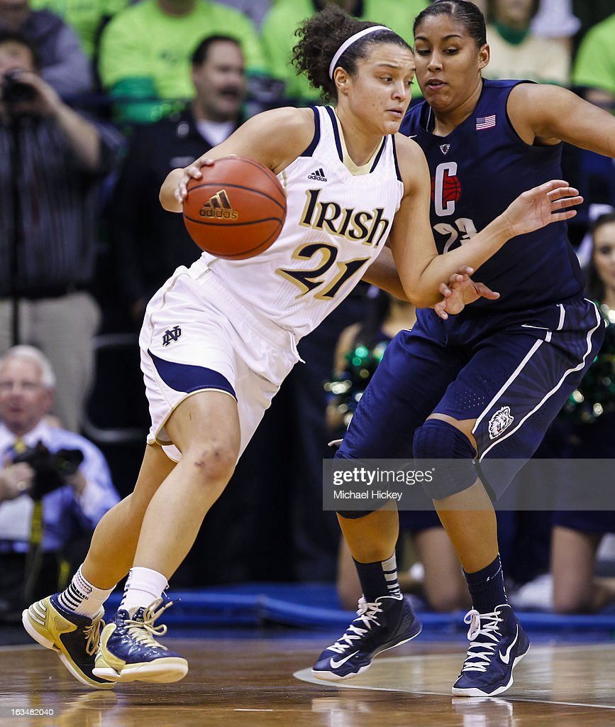 Kayla McBride #21 of the Notre Dame Fighting Irish dribbles the ball against Kaleena Mosqueda-Lewis #23 of the Connecticut Huskies at Purcel Pavilion on March 4, 2013 in South Bend, Indiana. Notre Dame defeated Connecticut 96-87 in triple overtime to win the Big East regular season title.