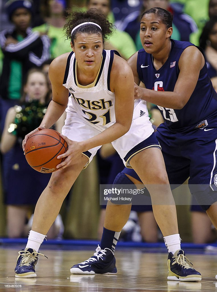 Kayla McBride #21 of the Notre Dame Fighting Irish holds the ball as Kaleena Mosqueda-Lewis #23 of the Connecticut Huskies defends at Purcel Pavilion on March 4, 2013 in South Bend, Indiana. Notre Dame defeated Connecticut 96-87 in triple overtime to win the Big East regular season title.