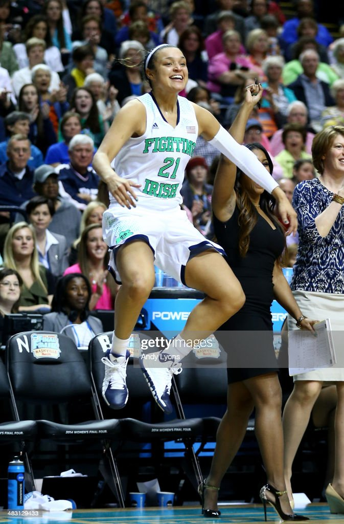 <a gi-track='captionPersonalityLinkClicked' href=/galleries/search?phrase=Kayla+McBride&family=editorial&specificpeople=9017392 ng-click='$event.stopPropagation()'>Kayla McBride</a> #21 of the Notre Dame Fighting Irish jumps in celebration on the bench in the second half against the Maryland Terrapins during the NCAA Women's Final Four semifinal at Bridgestone Arena on April 6, 2014 in Nashville, Tennessee.