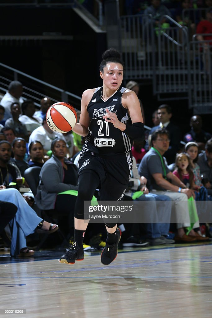 <a gi-track='captionPersonalityLinkClicked' href=/galleries/search?phrase=Kayla+McBride&family=editorial&specificpeople=9017392 ng-click='$event.stopPropagation()'>Kayla McBride</a> #21 of the San Antonio Stars brings the ball up court against the Dallas Wings on May 21, 2016 at College Park Center in Arlington, Texas.