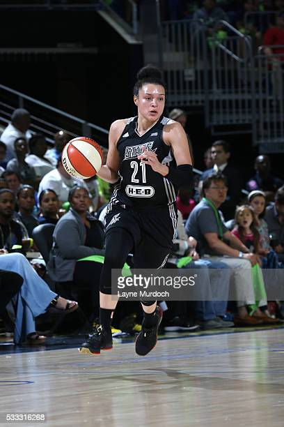 Kayla McBride of the San Antonio Stars brings the ball up court against the Dallas Wings on May 21 2016 at College Park Center in Arlington Texas...