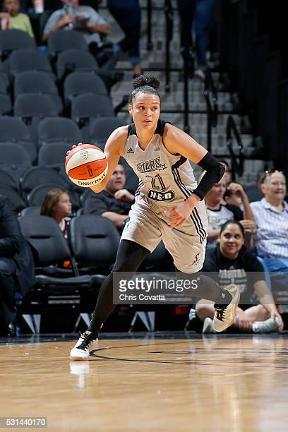 Kayla McBride of the San Antonio Stars defends the ball against the Atlanta Dream during the game on May 14 2016 at ATT Center in San Antonio Texas...