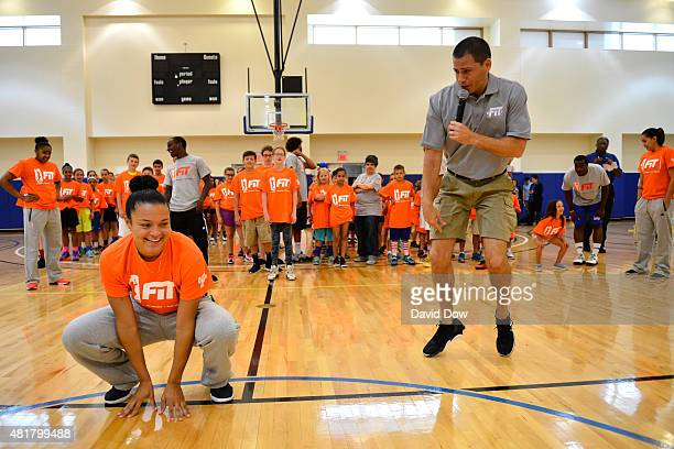 Kayla McBride of the San Antonio Stars demonstrates an excersise to young fans during a WNBA Fit AllStar Clinic presented by Kaiser Permanente at the...