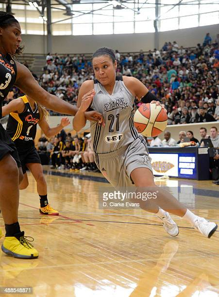 Kayla McBride of the San Antonio Stars drives against Courtney Paris at the Alamo Convocation Center on May 6 2014 in San Antonio Texas NOTE TO USER...