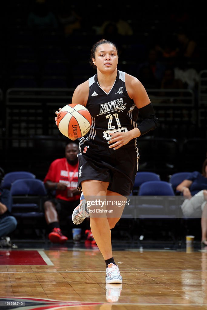 <a gi-track='captionPersonalityLinkClicked' href=/galleries/search?phrase=Kayla+McBride&family=editorial&specificpeople=9017392 ng-click='$event.stopPropagation()'>Kayla McBride</a> #21 of the San Antonio Stars drives against the Washington Mystics at the Verizon Center on June 29, 2014 in Washington, DC.
