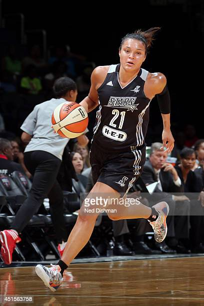 Kayla McBride of the San Antonio Stars drives against the Washington Mystics at the Verizon Center on June 29 2014 in Washington DC NOTE TO USER User...