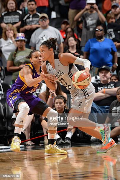 Kayla McBride of the San Antonio Stars drives to the basket against Armintie Herrington of the Los Angeles Sparks at ATT Center on June 14 2014 in...
