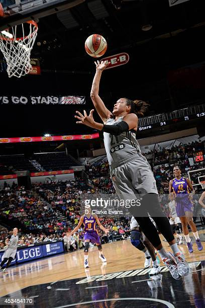 Kayla McBride of the San Antonio Stars drives to the basket against the Los Angeles Sparks at the ATT Center on August 10 2014 in San Antonio Texas...