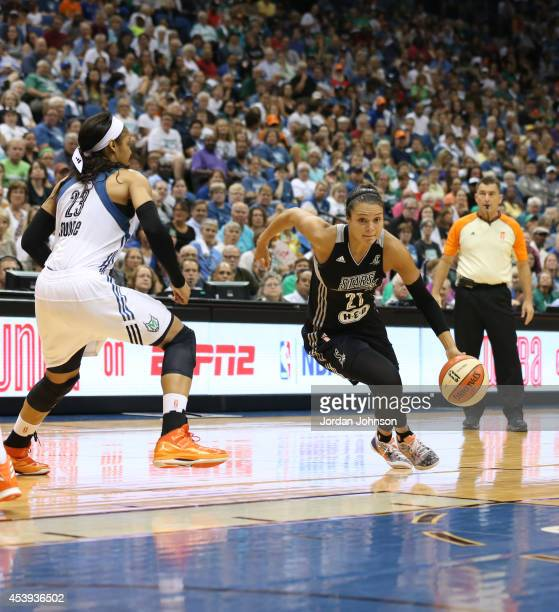 Kayla McBride of the San Antonio Stars drives to the basket against Maya Moore of the Minnesota Lynx in Game One of the Western Conference Semifinals...