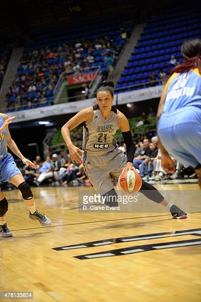 Kayla McBride of the San Antonio Stars drives to the basket against the Chicago Sky on June 20 2015 at Freeman Coliseum in San Antonio Texas NOTE TO...