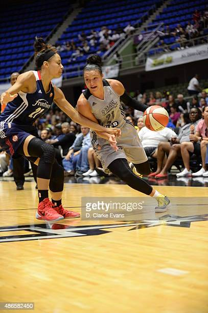 Kayla McBride of the San Antonio Stars drives to the basket against Jennifer Lacy of the Connecticut Sun on September 4 2015 at the Freeman Coliseum...
