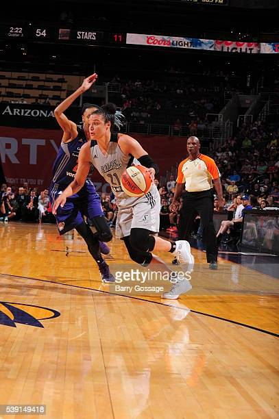 Kayla McBride of the San Antonio Stars drives to the basket against the Phoenix Mercury during the game on June 9 2016 at Talking Stick Resort Arena...