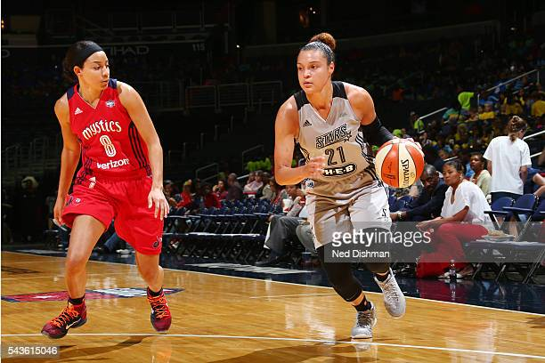 Kayla McBride of the San Antonio Stars drives to the basket against Bria Hartley of the Washington Mystics on June 29 2016 at the Verizon Center in...