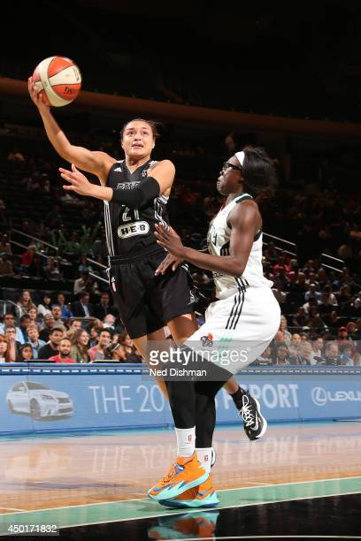 Kayla McBride of the San Antonio Stars drives to the basket during the game against the New York Liberty at Madison Square Garden on June 5 2014 in...
