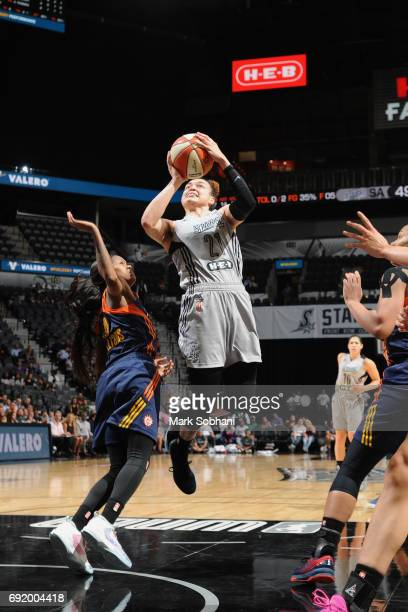 Kayla McBride of the San Antonio Stars goes to the basket against the Connecticut Sun on June 3 2017 at ATT Center in San Antonio Texas NOTE TO USER...