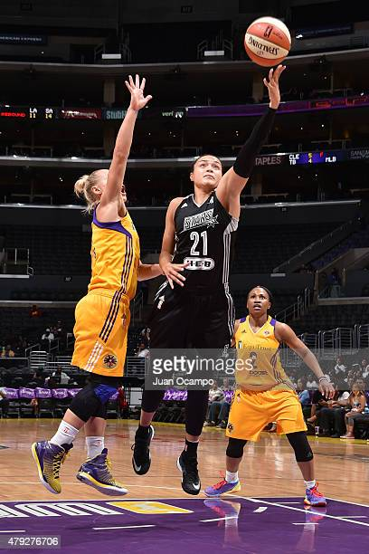 Kayla McBride of the San Antonio Stars goes up for a shot against the Los Angeles Sparks on July 2 2015 at Staples Center in Los Angeles California...