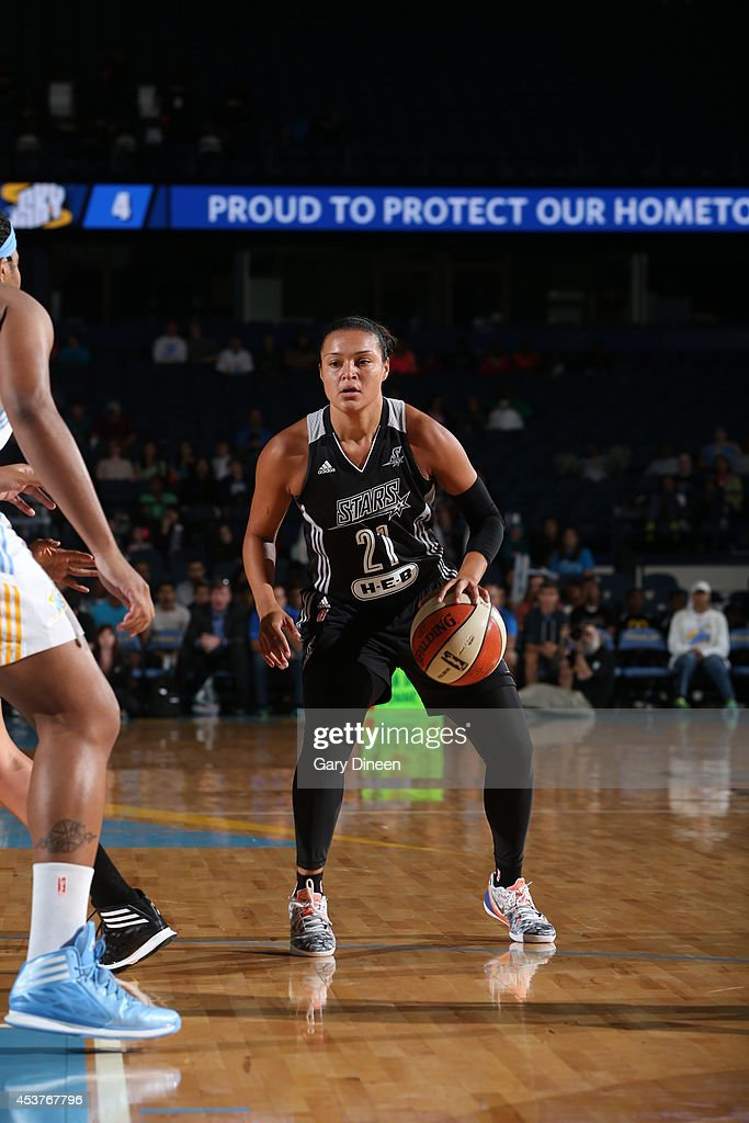 <a gi-track='captionPersonalityLinkClicked' href=/galleries/search?phrase=Kayla+McBride&family=editorial&specificpeople=9017392 ng-click='$event.stopPropagation()'>Kayla McBride</a> #21 of the San Antonio Stars handles the ball against the Chicago Sky during the game on August 17, 2014 at the Allstate Arena in Rosemont, Illinois.