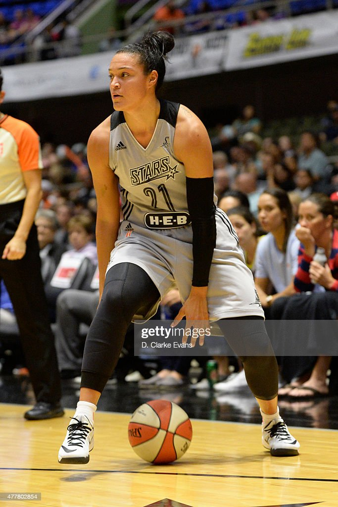 <a gi-track='captionPersonalityLinkClicked' href=/galleries/search?phrase=Kayla+McBride&family=editorial&specificpeople=9017392 ng-click='$event.stopPropagation()'>Kayla McBride</a> #21 of the San Antonio Stars handles the ball against the Minnesota Lynx at the Freeman Coliseum in San Antonio, TX on June 19, 2015 in San Antonio, Texas.