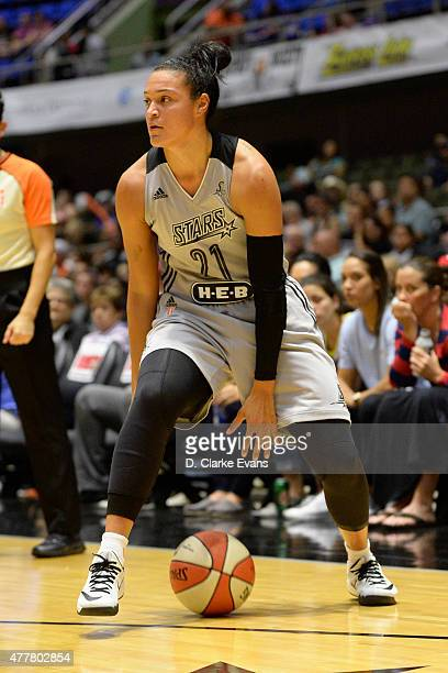 Kayla McBride of the San Antonio Stars handles the ball against the Minnesota Lynx at the Freeman Coliseum in San Antonio TX on June 19 2015 in San...