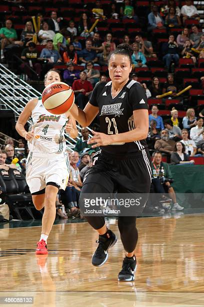 Kayla McBride of the San Antonio Stars handles the ball against the Seattle Storm August 28 2015 at Key Arena in Seattle Washington NOTE TO USER User...