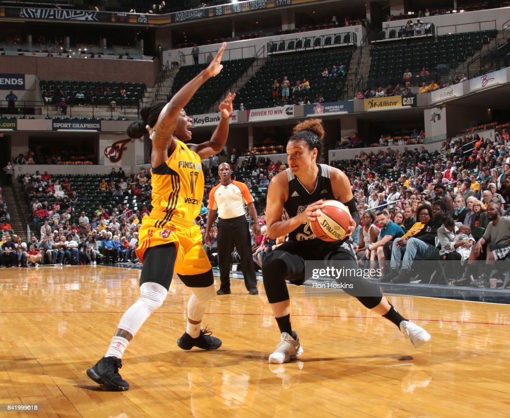 Kayla McBride #21 of the San Antonio Stars handles the ball against the Indiana Fever on September 2, 2017 at Bankers Life Fieldhouse in Indianapolis, Indiana.