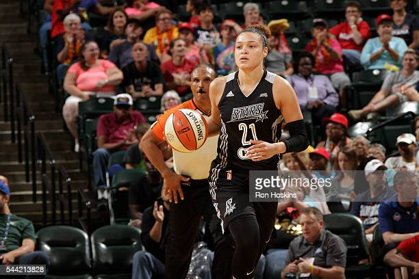 Kayla McBride of the San Antonio Stars handles the ball during the game against the Indiana Fever during their WNBA game at Bankers Life Fieldhouse...