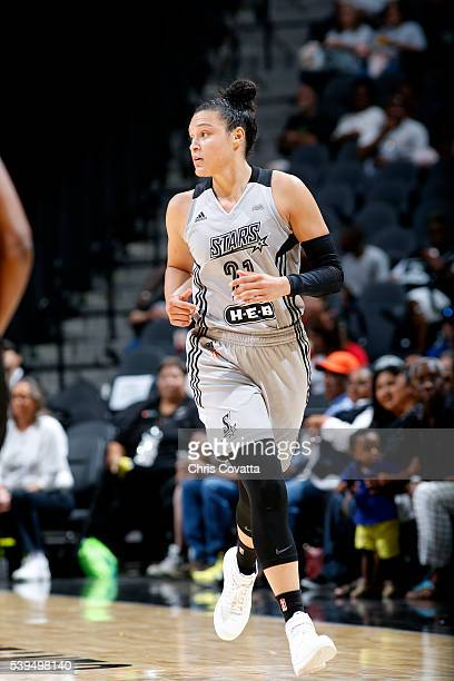Kayla McBride of the San Antonio Stars looks on during the game against the New York Liberty on June 11 2016 at the ATT Center in San Antonio Texas...