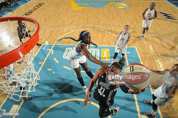 Kayla McBride of the San Antonio Stars shoots against Gennifer Brandon of the Chicago Sky on August 17 2014 at the Allstate Arena in Rosemont...