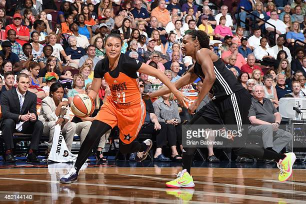 Kayla McBride of the Western Conference All Stars drives against the Eastern Conference All Stars during the Boost Mobile WNBA AllStar 2015 Game at...
