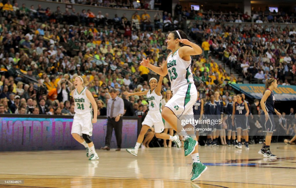 Kayla McBride #23, <a gi-track='captionPersonalityLinkClicked' href=/galleries/search?phrase=Skylar+Diggins&family=editorial&specificpeople=5791961 ng-click='$event.stopPropagation()'>Skylar Diggins</a> #4 and Natalie Novosel #21 of the Notre Dame Fighting Irish celebrate after they won 83-75 in overtime against the Connecticut Huskies during the National Semifinal game of the 2012 NCAA Division I Women's Basketball Championship at Pepsi Center on April 1, 2012 in Denver, Colorado.