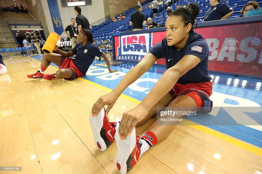 <a gi-track='captionPersonalityLinkClicked' href=/galleries/search?phrase=Kayla+McBride&family=editorial&specificpeople=9017392 ng-click='$event.stopPropagation()'>Kayla McBride</a> #34 stretches before the Women's Senior U.S. National Team Red vs White game on September 11, 2014 in Newark, DE.