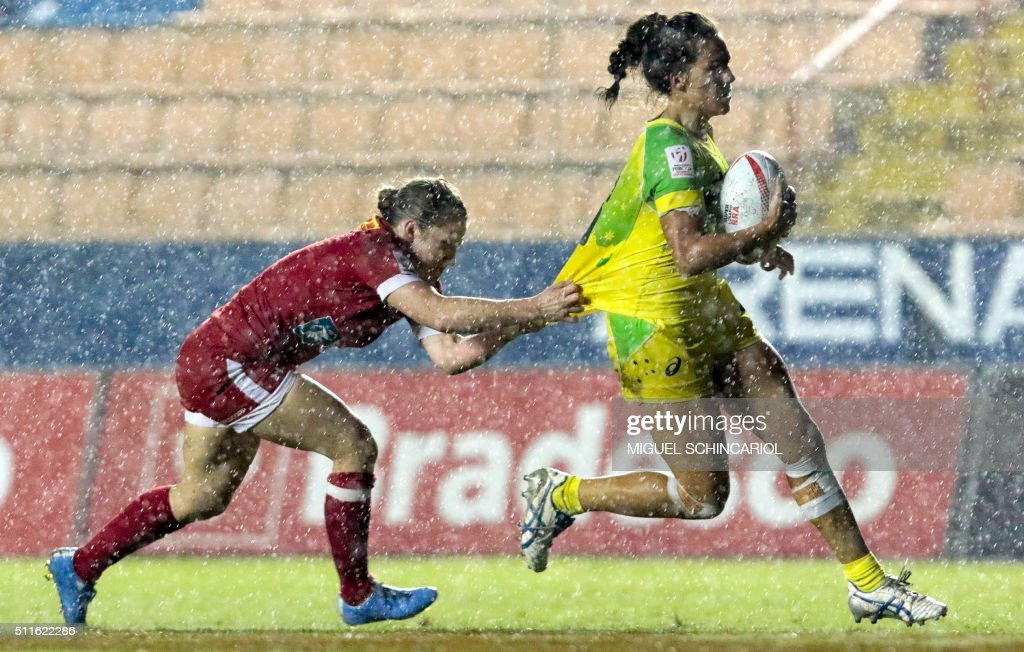TOPSHOT Kayla Moleschi of Canada vies for the ball with Evania Pelite of Australia during their World Rugby Women's Sevens Series match in Barueri...