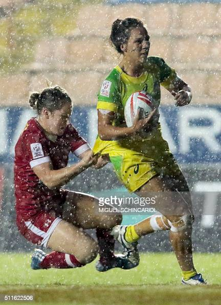Kayla Moleschi of Canada vies for the ball with Evania Pelite of Australia during their World Rugby Women's Sevens Series match in Barueri some 30 km...
