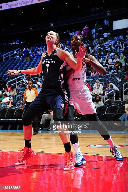 Kayla Pedersen of the Connecticut Sun boxes out against Delisha MiltonJones of the Atlanta Dream on August 25 2015 at Philips Arena in Atlanta...