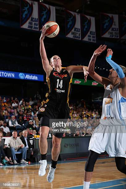 Kayla Pedersen of the Tulsa Shock goes to the basket past Elena Delle Donne of the Chicago Sky during the game on June 2 2013 at the Allstate Arena...