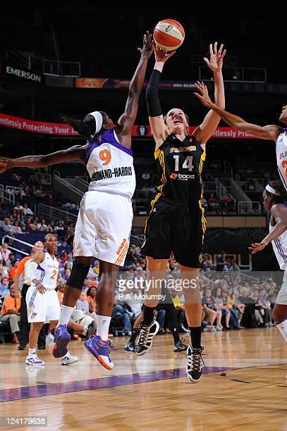 Kayla Pedersen of the Tulsa Shock shoots against Marie FerdinandHarris of the Phoenix Mercury on September 8 2011 at US Airways Center in Phoenix...
