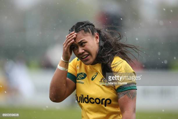 Kayla Sauvao of Australia shields her face from hail during the International Women's Test match between the New Zealand Silver Ferns and the...