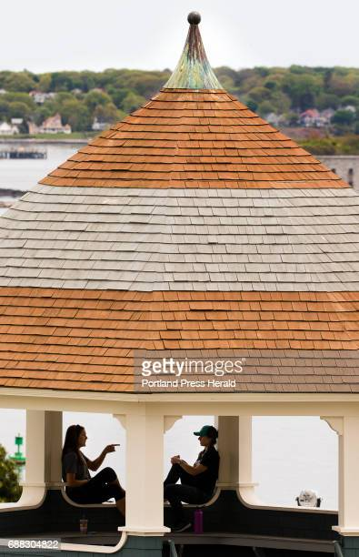 Kaylee Wheeler of Westbrook and Raechel Allen of Portland catch up before work in the Fort Allen gazebo in Portland on Wednesday May 24 2017