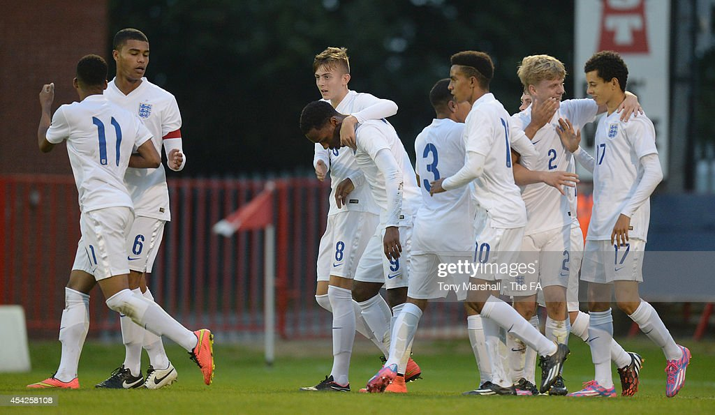 Kaylen Hinds of England celebrates with his team mates after scoring their first goal during the Under 17 International match between England U17 and Czech Republic U17 at Aggborough Stadium on August 27, 2014 in Kidderminster, England.