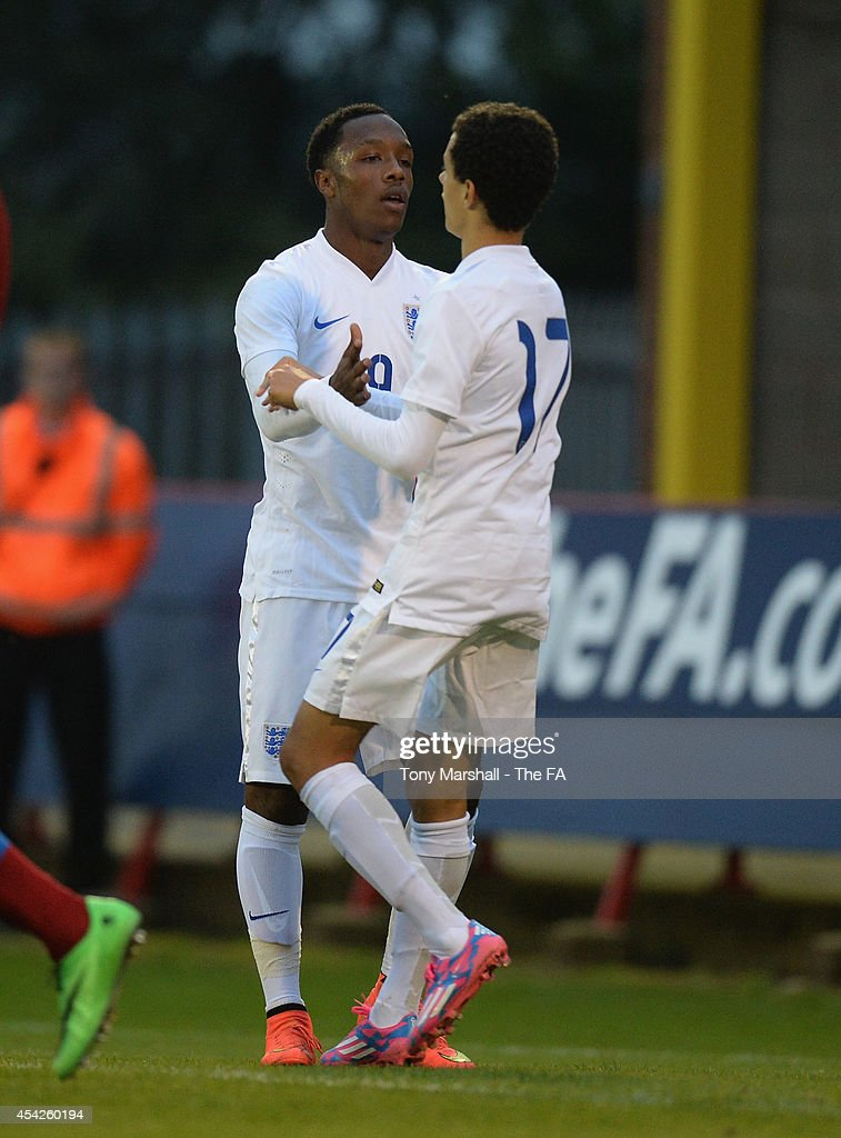 Kaylen Hinds of England celebrates with Nathan Holland after scoring their first goal during the Under 17 International match between England U17 and Czech Republic U17 at Aggborough Stadium on August 27, 2014 in Kidderminster, England.