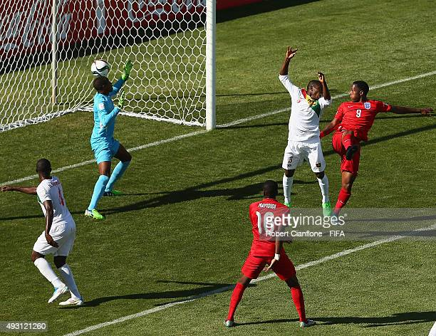 Kaylen Hinds of England heads the ball past Guinea goalkeeper Moussa Camara to score during the FIFA U17 World Cup Group B match between England and...