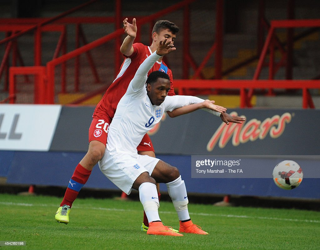 Kaylen Hinds of England is tackled by Matej Chalus of Czech Republic during the Under 17 International match between England U17 and Czech Republic U17 at Aggborough Stadium on August 27, 2014 in Kidderminster, England.