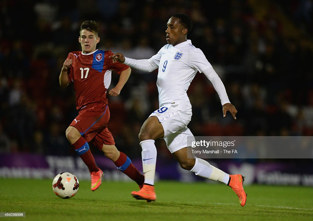 Kaylen Hinds of England persued by Tomas Balvin of Czech Republic during the Under 17 International match between England U17 and Czech Republic U17 at Aggborough Stadium on August 27, 2014 in Kidderminster, England.