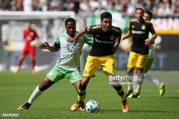 Kaylen Hinds of VfL Wolfsburg and Nuri Sahin of Borussia Dortmund during the Bundesliga match between VfL Wolfsburg and Borussia Dortmund at...