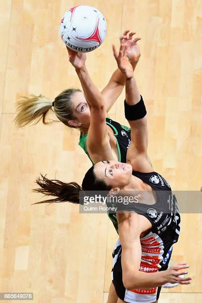 Kaylia Stanton of the Fever and Sharni Layton of the Magpies compete for the ball during the round eight Super Netball match between the Magpies and...